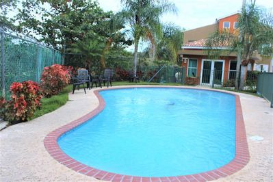 Community pool with air conditioned clubhouse, kitchen,bathrooms, outdoor shower