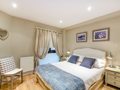 Photo for Beautiful ground floor flat in South Kensington, near tube, museums & amenities.