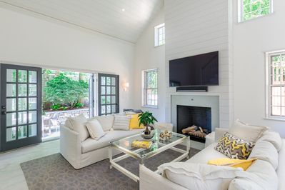 Living room opens to expansive outdoor living space