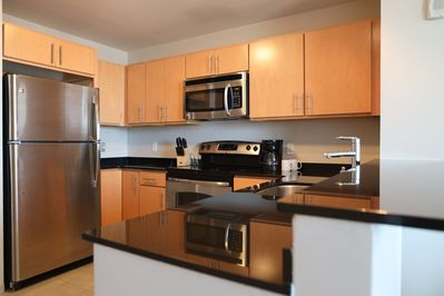 Kitchen Features Stainless and Black Appliances