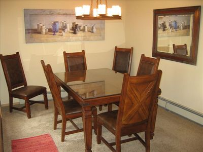 Separate dining room comfortably seats six.