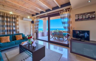 Photo for Hill Top Villa with stunning sea views, close to the beach and centrally located