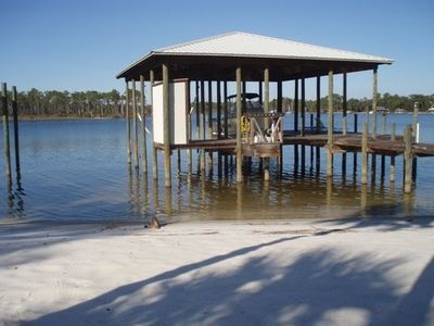 White sandy beach, boathouse, boat and jet ski lift. Free use of ocean kayak.