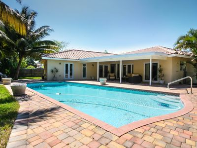 Photo for Newly renovated home, heated salt water pool, walk to the beach, & so much more!