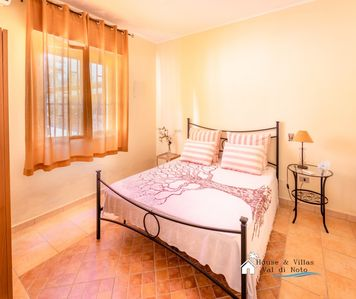 Photo for 350 meters from the beach, air conditioning, private parking, BBQ area