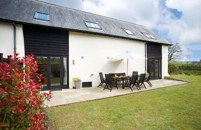 Photo for A combination of two properties sitting next door to each other, ideal for larger parties.