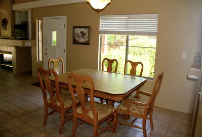 The dining table has room for six guests.