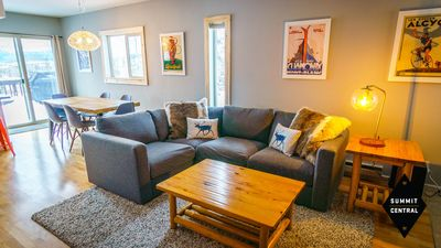 Living room with sectional and love seat.