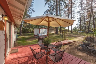 Sit on the back porch & relax while cooking your dinner on the Bar B Q