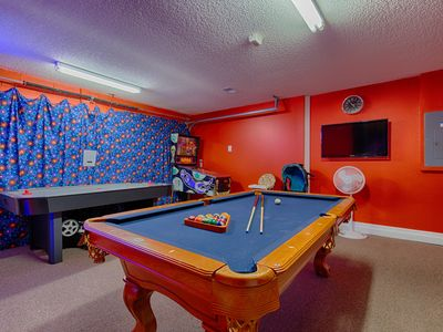 Game Room with Pub Table, TV, Air Hockey, and PinBall