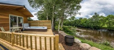Photo for A riverside lodges with spa pool  (dog friendly) that sleeps 4 guests  in 1 bedroom