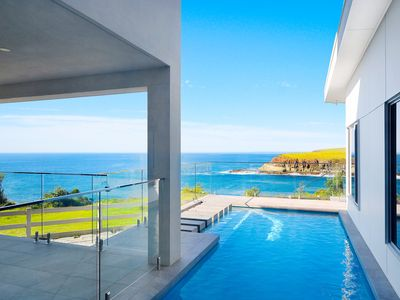 Photo for Clifftop ocean vista - stylish boutique apartment