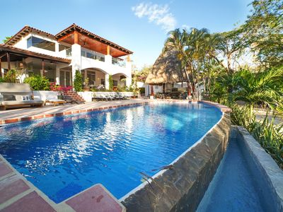 Photo for Summer Sale! -Tropical, Spanish Style, Luxury 9 Bedroom, 9 1/2 BA Beachfront Home