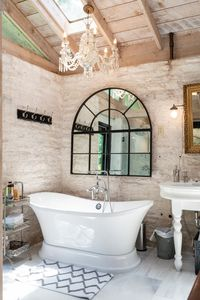 Pedestal Tub in Master Bath has 4 skylights and overlooks back yard and pool.