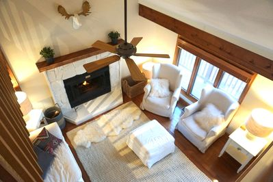 Main living room with wood burning fire.  Shot from above.