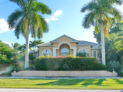 Photo for Spacious waterfront house on corner lot w/ heated pool & short walk to beach