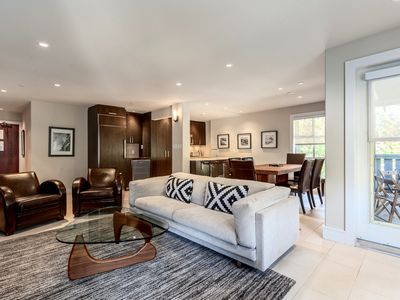 Open plan living area with designer furniture, gas fire place and big screen TV