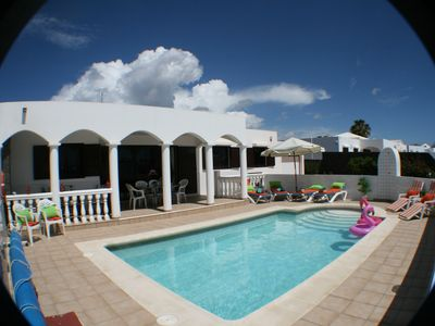 Photo for 4 Bedroom, 3 Bathroom,  Heated gated Pool, 10 mins walk to beach, restaurants