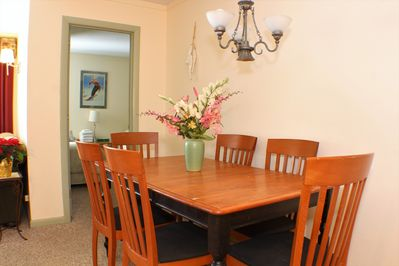 <center>Dining area with beautiful wood table<center>