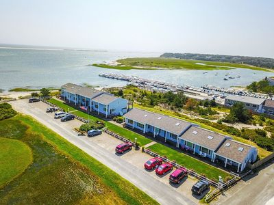 Photo for Beachfront and marina access, views and ocean breezes !