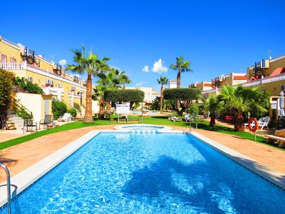 Photo for La Zenia Townhouse with Shared Pool and 10 Minutes Walk to Beach