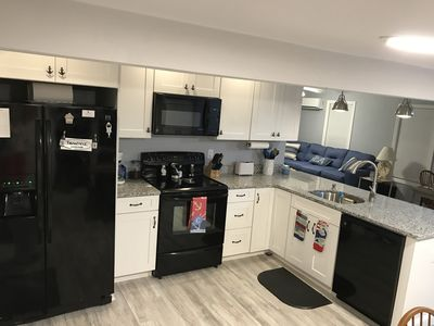 Kitchen w/electric stove, microwave, coffee maker, dishwasher,sink, toaster.
