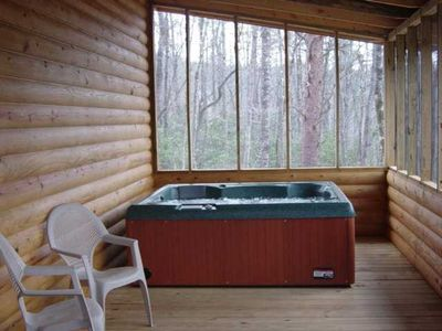 Private hot tub on a screened back porch with a mountain view late fall-spring