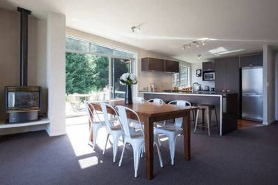 Dining table for 6, kitchen, side entrance and gas fire