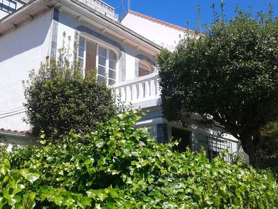 Photo for Beautiful beachfront apartment with a garden in the centre of Coruña
