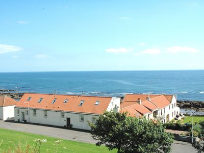 Photo for Newly renovated seafront cottage with stunning 180 degree panoramic sea views