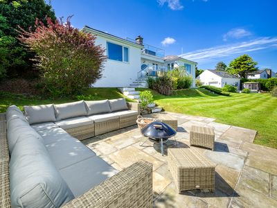 Photo for Truly stunning in every respect, this very special property boasts the luxuries of a full-size tenni