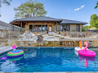 Photo for AMAZING WATERFRONT HOME WITH 2 LARGE POOLS, FUN WATER-SLIDE FOR KIDS, AND MORE!