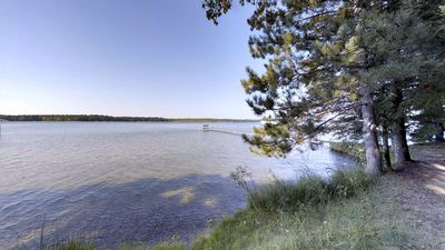 There's a beautiful lake view down a private path from your cabin.
