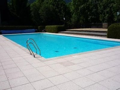 Photo for Apartment of character with fireplace in the summer residence with swimming pool