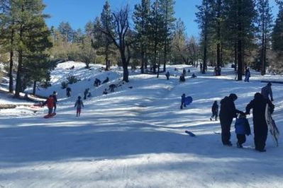 Free sledding and family fun just a few steps away from Dream Getaway!