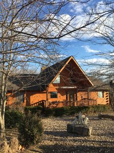 Photo for Wilderness Retreat 4 br; 4 b Log Home w/Pool table. 1 Mile from Legends of Golf