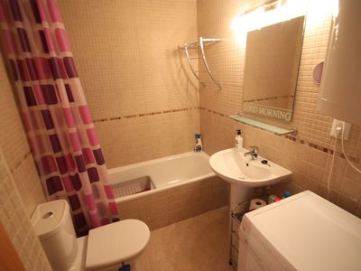 Photo for Modern apartment with beautiful terrace and pool free wifi free channels