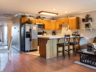 Photo for 304   Main Level Condo, New Flooring, Mountain Views, Close to Pools, and more!