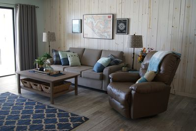 Living area with sofabed and recliner.
