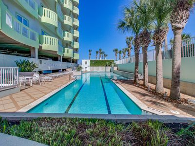 Photo for Gulf-front condo w/ shared pools, gym & BBQ area - close to beach!