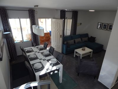 Lounge area with flat screen TV and comfortable double sofabed