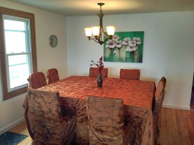 Granite tables and standard dining chairs for family style eating
