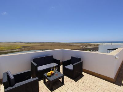 Photo for Modern apartment near the beach with roof terrace and sea view