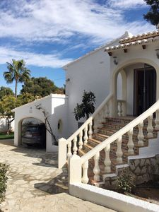 Villa from front, carport and steps to front door