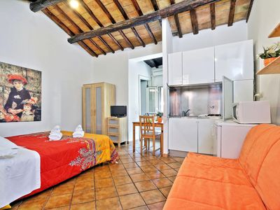 Photo for Spacious Baccina Monti apartment in Centro Storico with WiFi & integrated air conditioning.