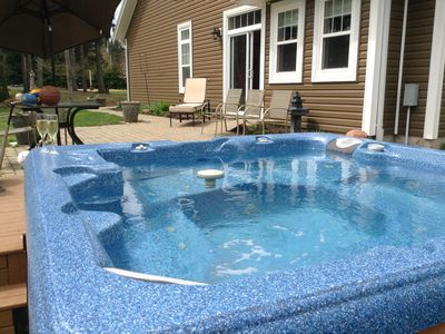 Photo for JUNE SPECIALS!July vacancy. hot tub/private yard. Central location. Instant book
