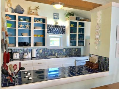 Kitchen with modern cabinet look, custom backsplash and glass cooktop!