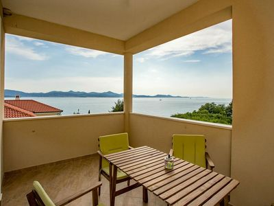 Photo for Spacious apartment with beautiful sea view terrace only 30m from pebbly beach
