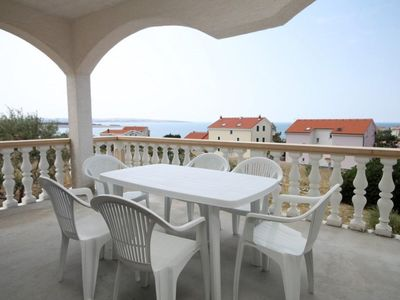 Photo for Two bedroom apartment with terrace and sea view Povljana, Pag (A-224-e)