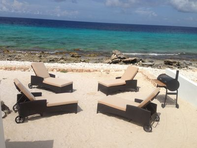 Your private sandy beach with lounge chairs and a large bbq grill.
